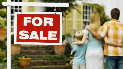 For Sale Sign on Front Lawn