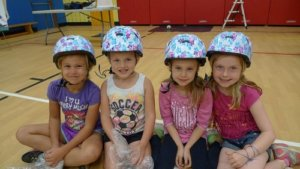 4 girls with helmets on
