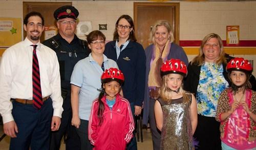 Volunteers giving helmets to kids